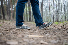 Feet of a running woman in the forest Royalty Free Stock Photography