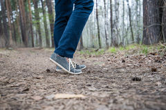 Feet of a running woman in the forest Stock Photography