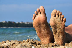 Feet in sand. On a beach Royalty Free Stock Image
