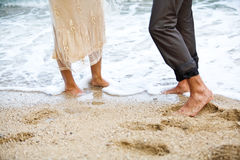 Feet in the sand. Royalty Free Stock Image