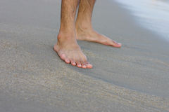 Feet on a Sand Royalty Free Stock Image