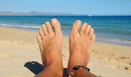 Feet on the sand Stock Photo