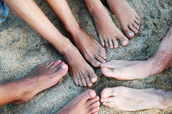 Feet on the sand. Friend feet on the sand royalty free stock photography