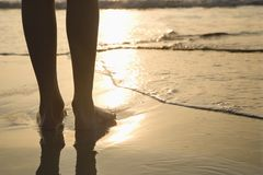Feet in sand. Royalty Free Stock Photography