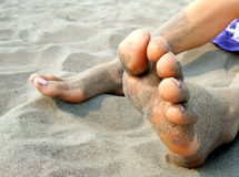 Feet in sand. Closeup of bare feet and toes in fine sand royalty free stock photography
