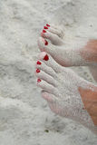 Feet in sand Stock Photos