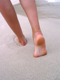 Feet on sand Stock Image