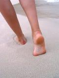 Feet on sand. Woman walking trough the sand beach stock image