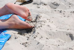 Feet in the sand Stock Photography