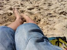 Feet in sand. At beach Royalty Free Stock Photo