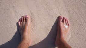 Feet in the sand on the beach. Mexico stock footage
