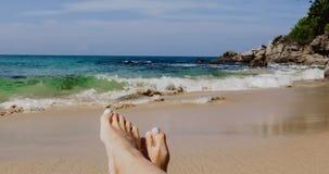 Feet in the sand on the beach. Female feet in the sand on sea beach stock video
