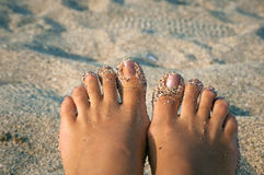 Feet in sand on the beach Royalty Free Stock Images