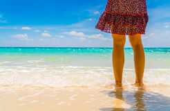 Feet on the sand with Beautiful tropical Maldives island . Royalty Free Stock Images