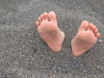 Feet in sand Stock Image