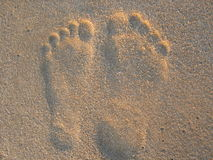 Feet on sand Stock Photography