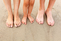 Feet in the sand Stock Image