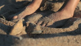 Feet in the sand. stock footage