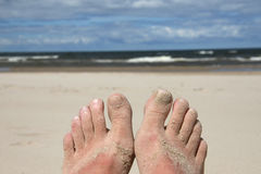 Feet in sand Royalty Free Stock Photos