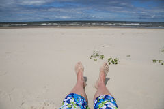 Feet in sand Royalty Free Stock Images