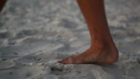 Feet in the sand stock video footage