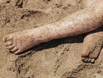 Feet on the sand. Legs and feet on the sand, costa brava Stock Image