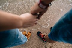 Feet on the sand near the water royalty free stock images