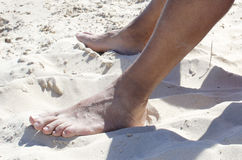 Feet in the sand Royalty Free Stock Image