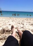 Feet in sand. Relaxing with feet in sand at beach Royalty Free Stock Photo