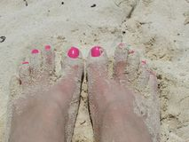 Feet in the sand stock photo