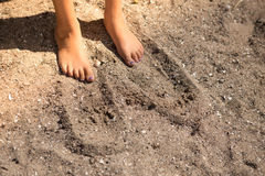 Feet in the sand. Small childrens feet in the sand Royalty Free Stock Photo