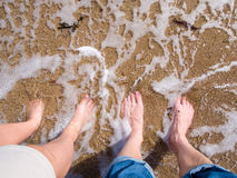 Feet in the sand and water. Of the ocean Stock Photography
