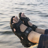 Feet in sandals Royalty Free Stock Photos