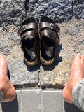 Feet and sandals during a rest Royalty Free Stock Photography