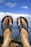 Feet and sandals with a view Stock Images
