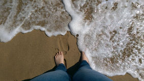 Feet on a sandy beach Stock Image