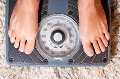 Feet on scale Royalty Free Stock Images