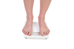 Feet on scales. Stock Photo
