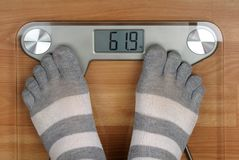 Feet on the scales Stock Photography
