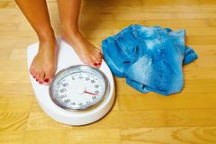 Feet on scales Stock Photography