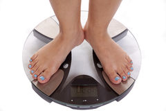 Feet on scales blue toenails Stock Photos