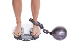 Feet on scales chained Stock Images