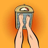 Feet on the scales. diet and weight. Comic book cartoon pop art retro illustration Royalty Free Stock Photography