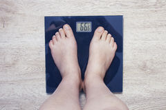 Feet on scales. Excess weight Royalty Free Stock Photography