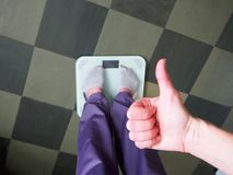 Feet on scales on floor in room stock images