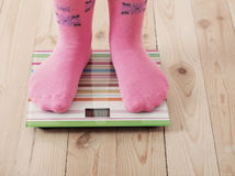 Feet on scales on floor Royalty Free Stock Photography