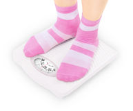 Feet on scales Royalty Free Stock Photo