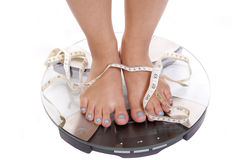Feet scales tape blue toenails Stock Image