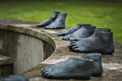 Feet sculpture in Kungsbacka Sweden. KUNGSBACKA, SWEDEN - July 21, 2017. Public art by Vladimir Stoces depicting childrens feet, namned `Circle of flowers Royalty Free Stock Photos