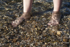 Feet in the sea Royalty Free Stock Photography